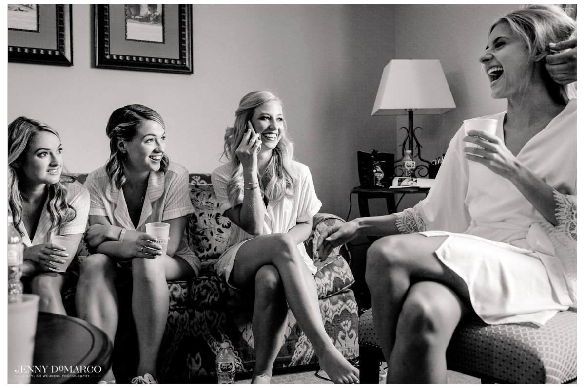 Bride shares a couple of laughs with her bridesmaids as they get ready.