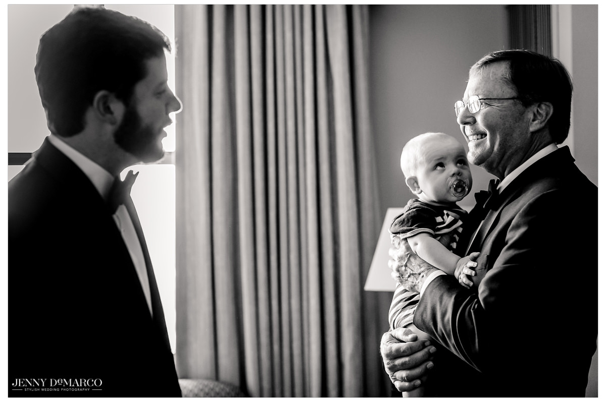 Groom's father shares a moment with his son.