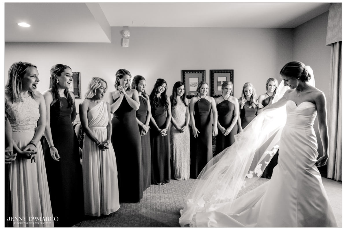 Bride gives her bridesmaid a twirl now that her look is complete.