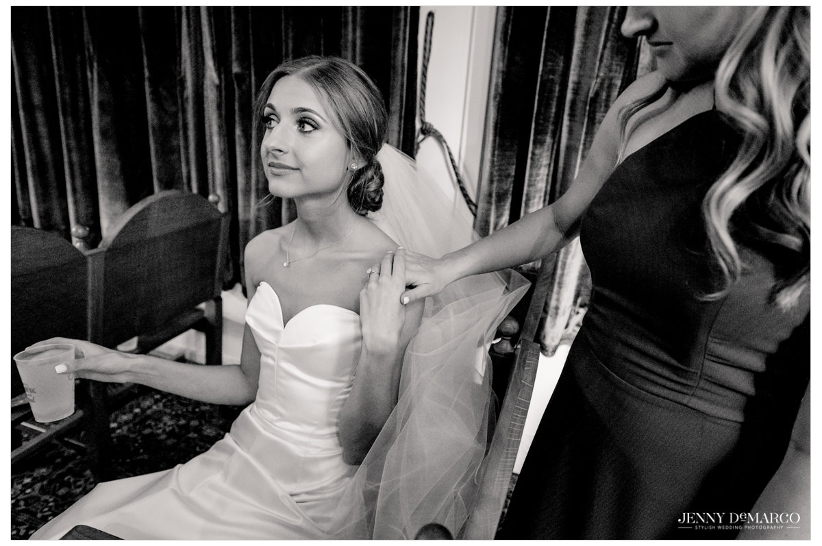 Bride relaxes with her fellow bridesmaids.