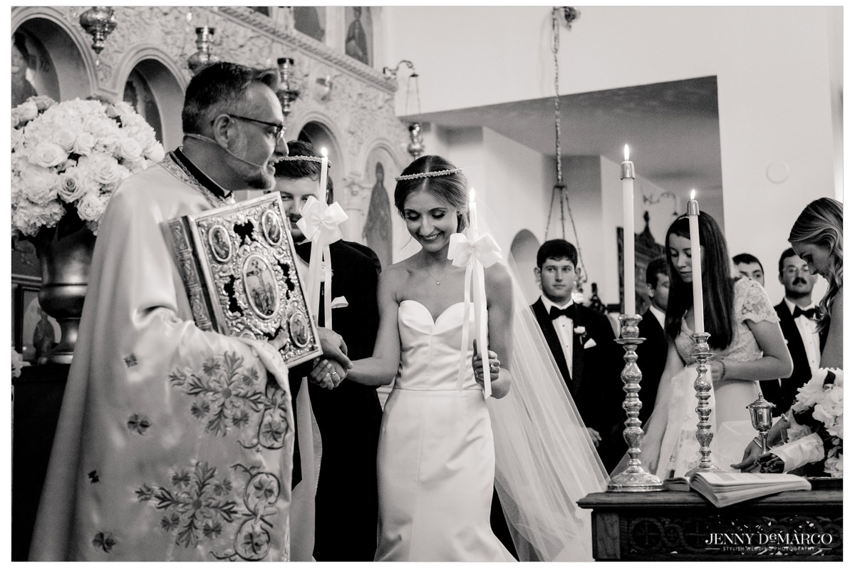 Bride and groom perform a religious ceremony for all to witness.