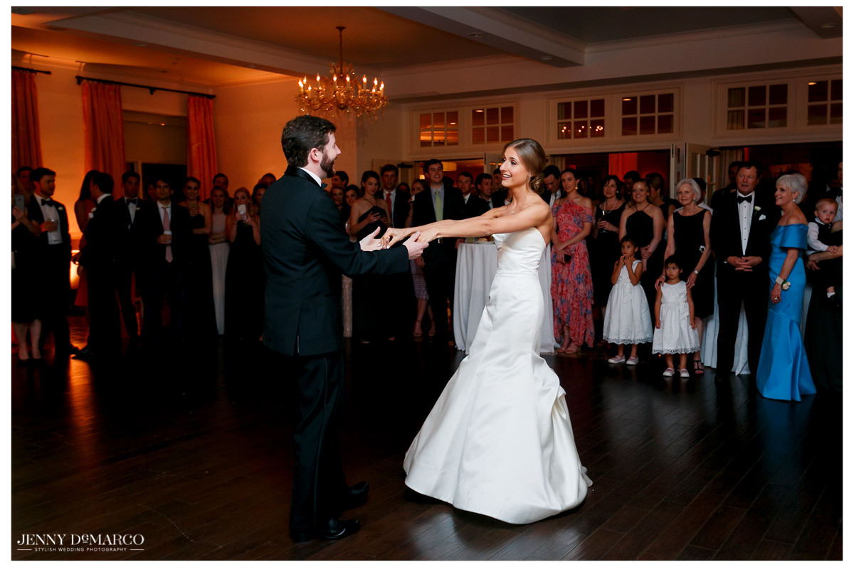 Bride and groom share their first dance together.