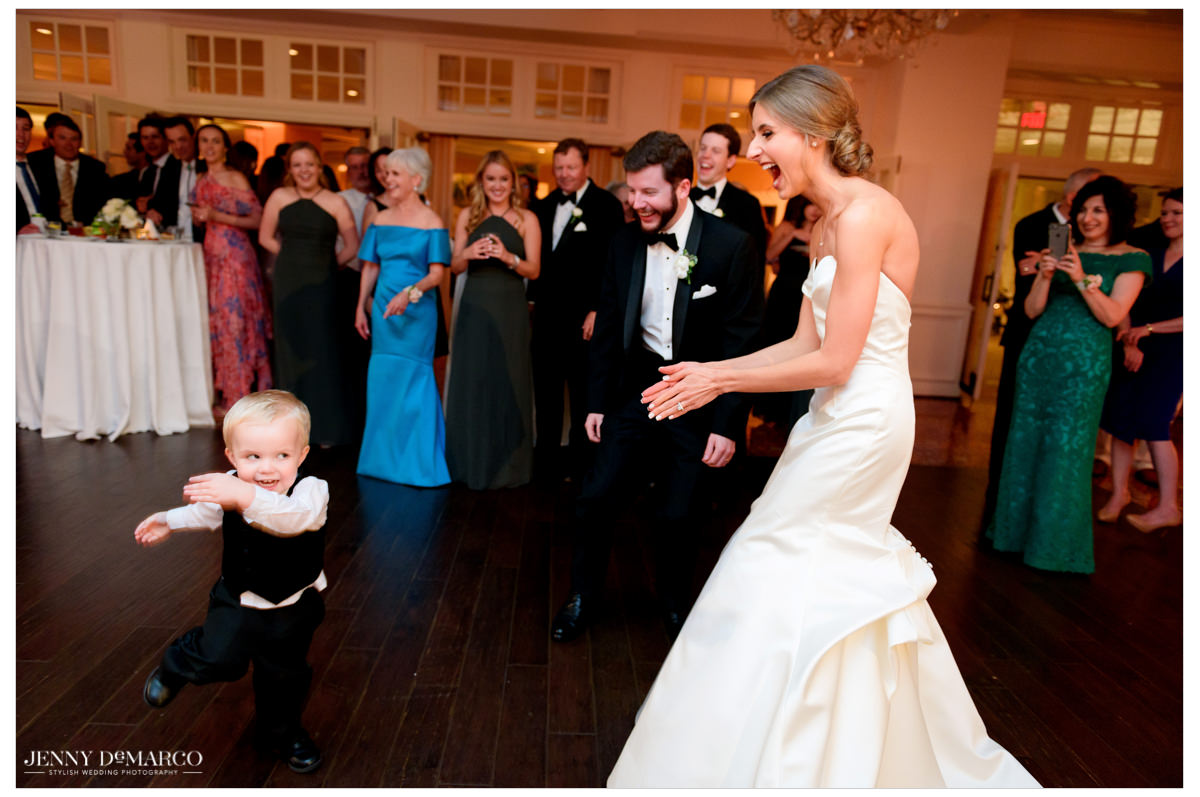 A little boy joins them on the dance floor.