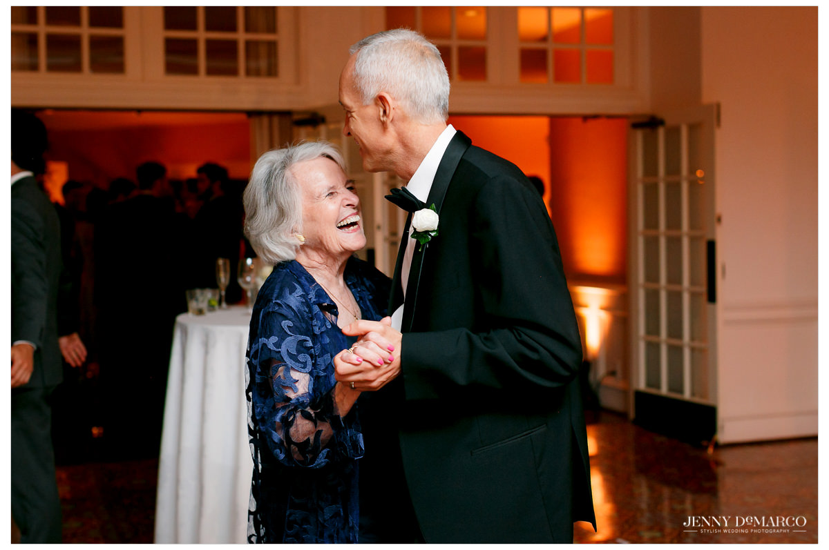 Two guests share a sweet dance together.