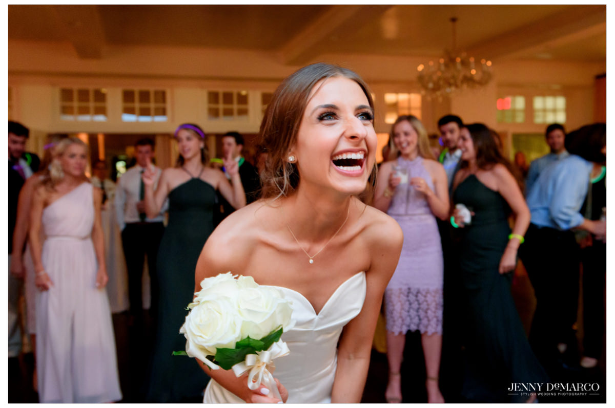 Bride prepares herself for the bouquet toss.