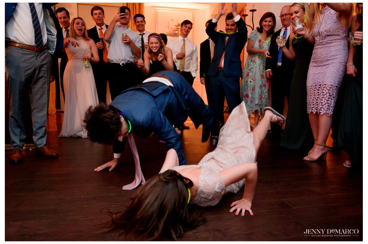 Two guests do the worm at the reception.