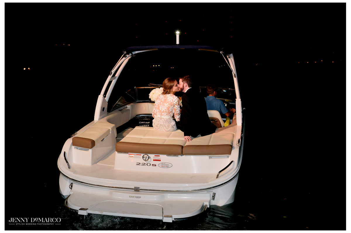 The couple rides off on a boat sharing a kiss.