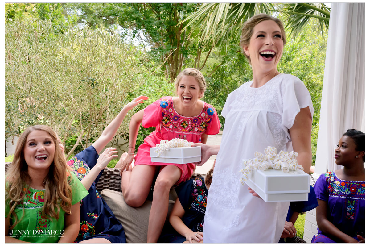 Bride hands out bridesmaid's gifts.