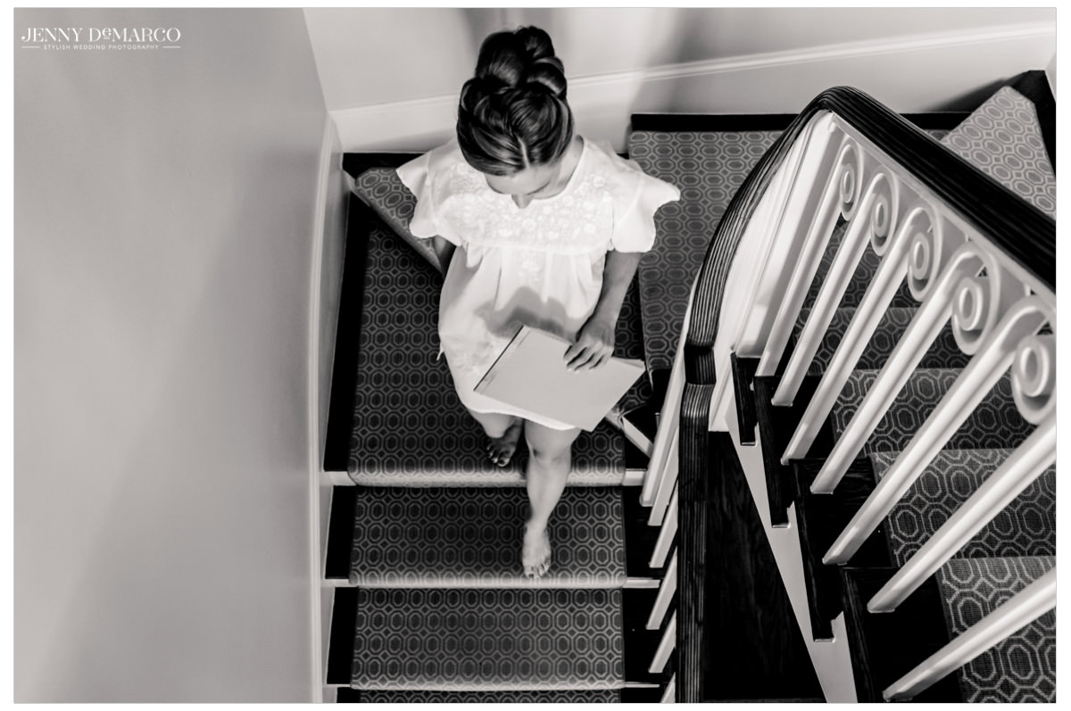 Bride walks down the stairs to hang out a gift.