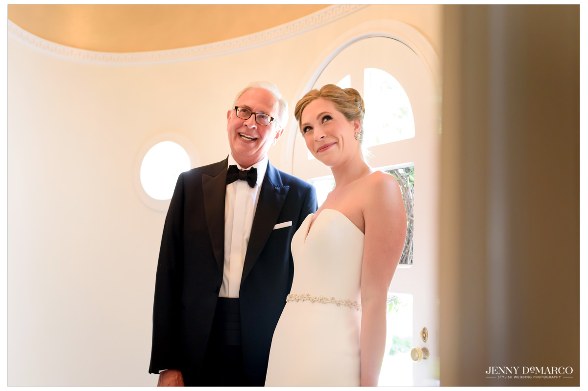 Bride poses with her father.