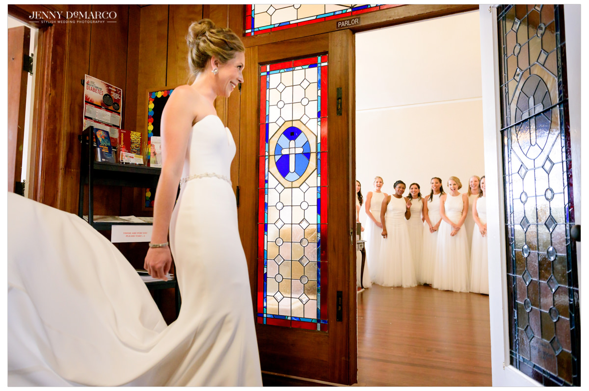 Bride showing off her look to her bridesmaids for the first time.