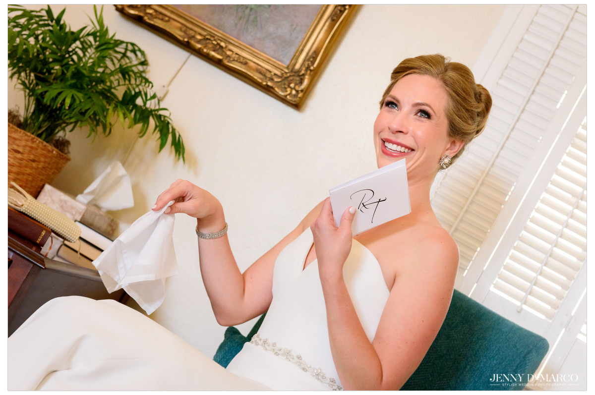 Bride reading a letter and crying.