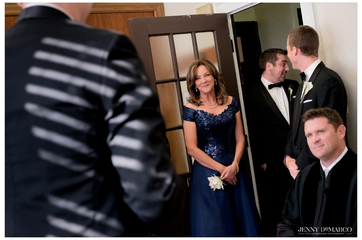 Mother of the groom looks sweetly at her boy.