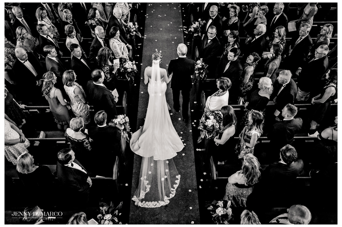 An above shot of the bride being walked down the aisle by her father.