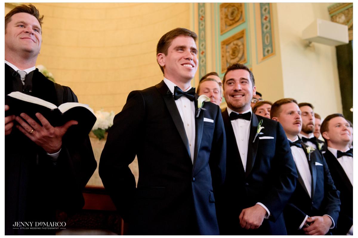 Groom smiles at his bride.