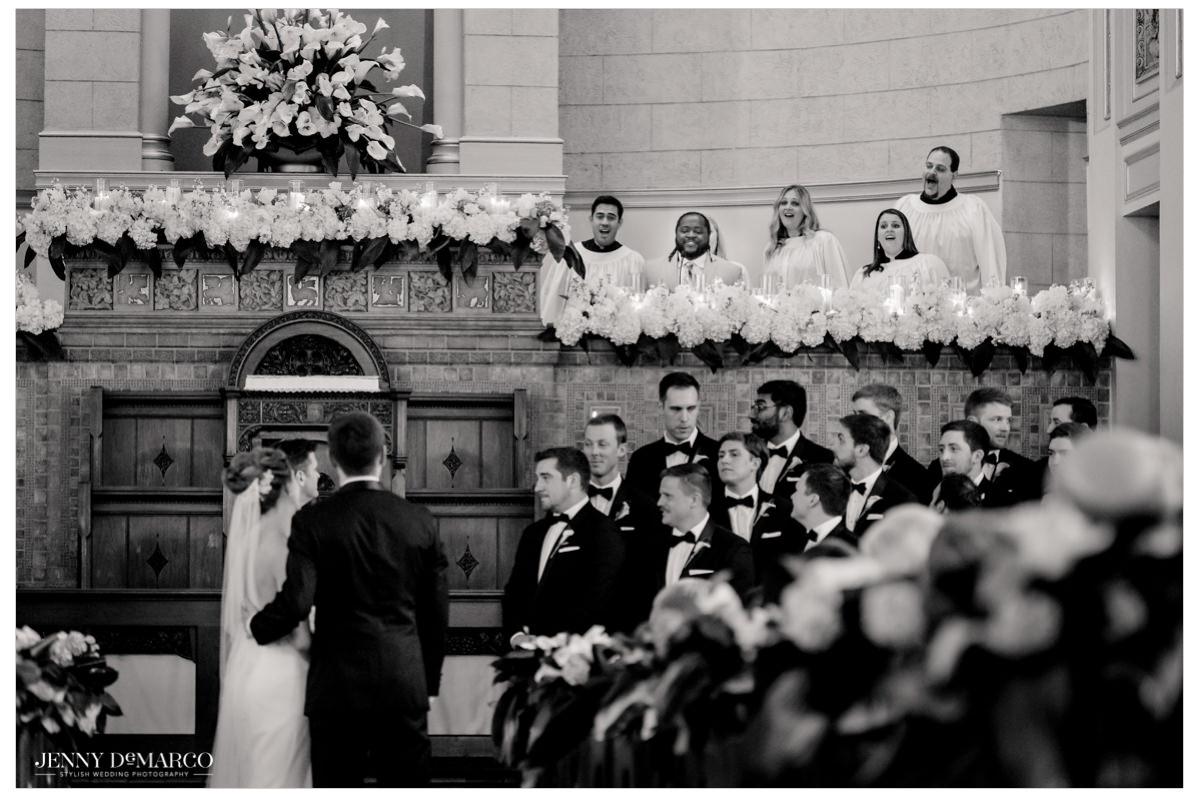 A choir begins to sing.