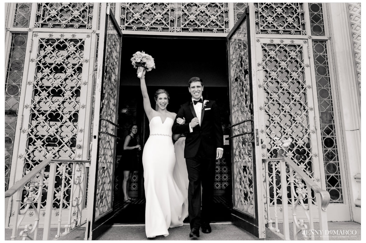 The couple exits the church.