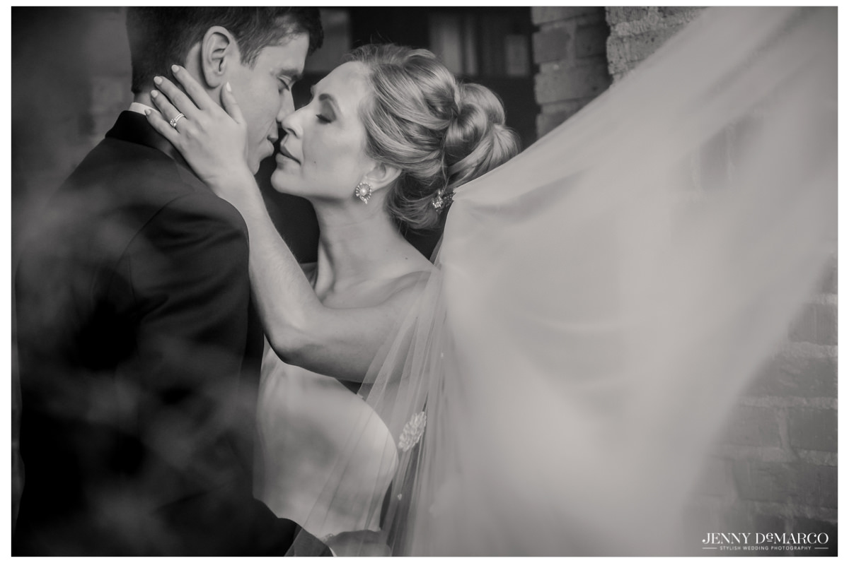 An intimate photo of the bride and groom kissing.