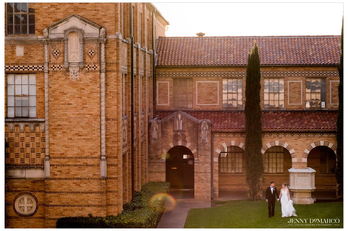 A wide angle photo of the bride and groom in front of the church.