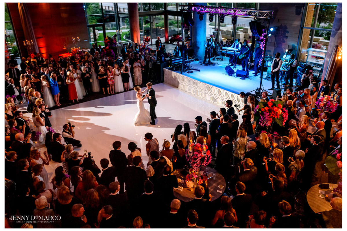 Wide angle photo of the couple dancing their first dance.