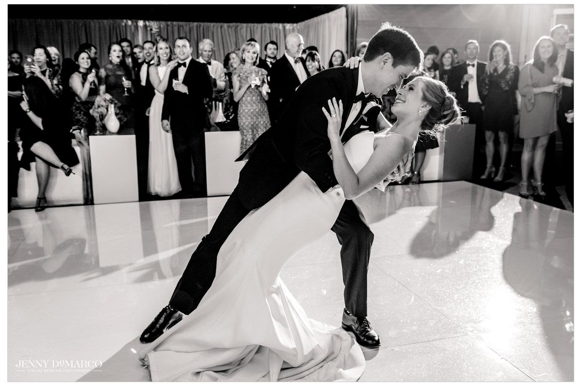 Grooms dips his bride.