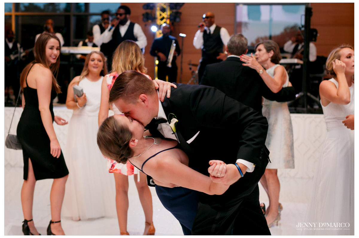 Guests dance and kiss.