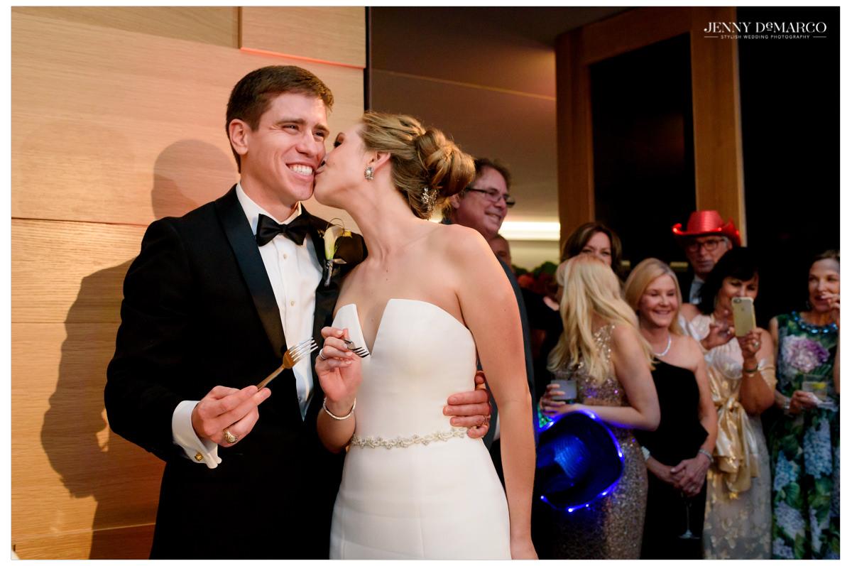 Bride kisses her husband.