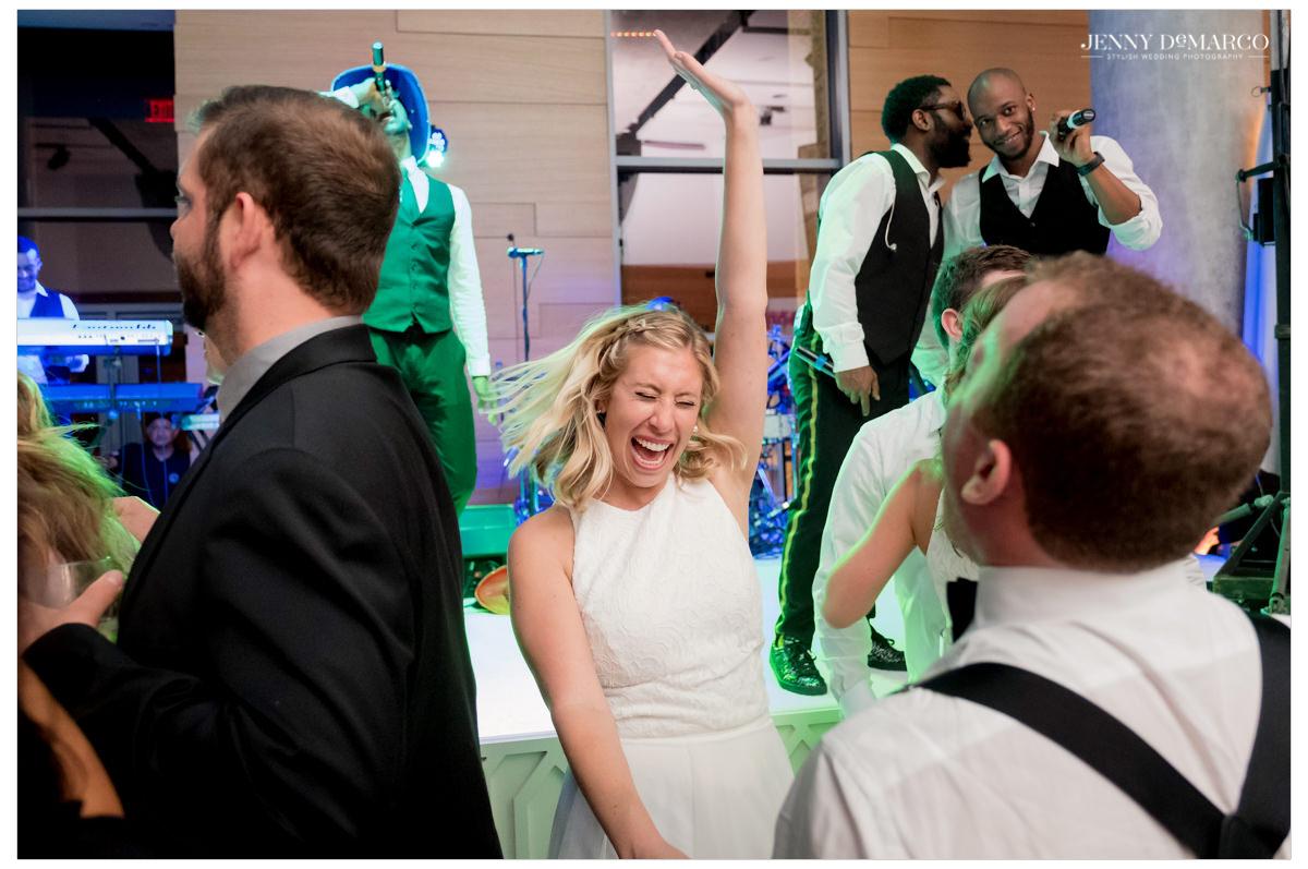 Guests shake their head dancing.