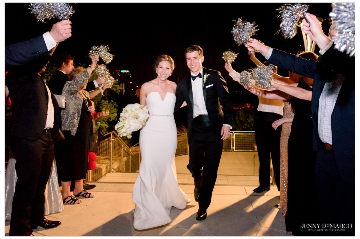 Bride and groom exit reception.