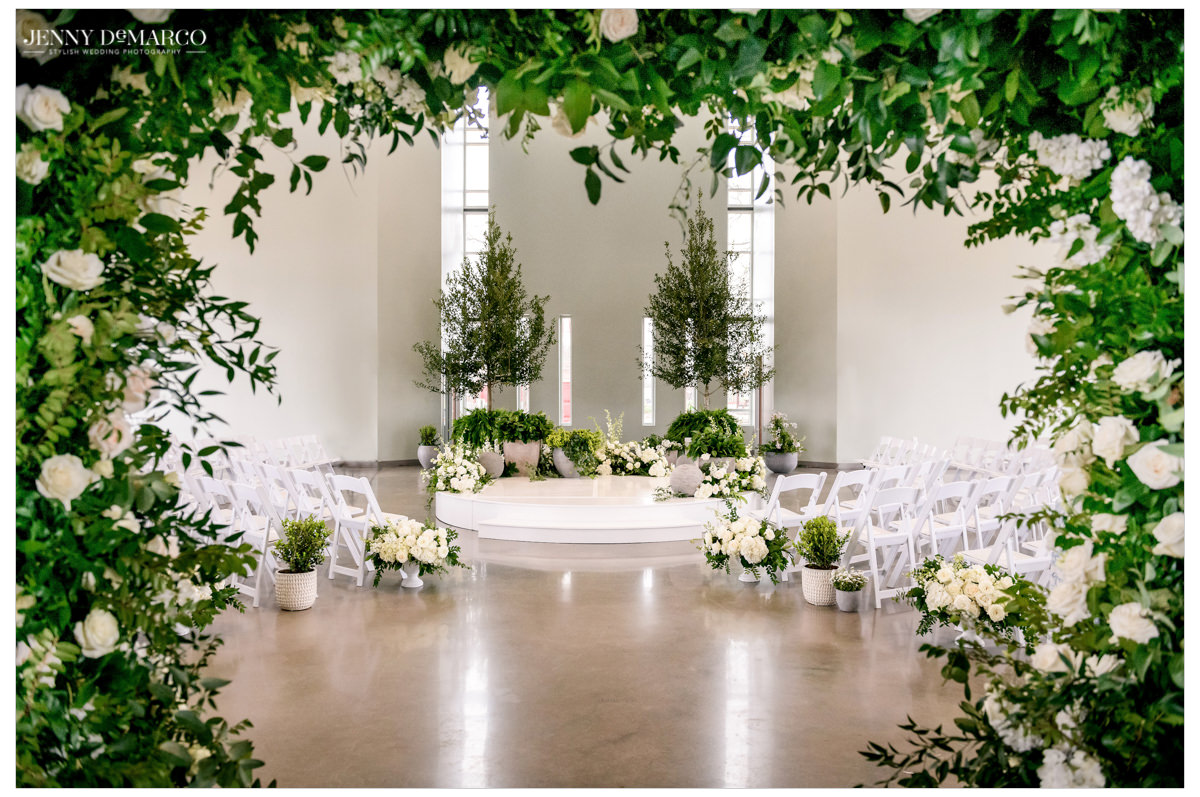 Green and white florals surrounded the wedding ceremony's altar.