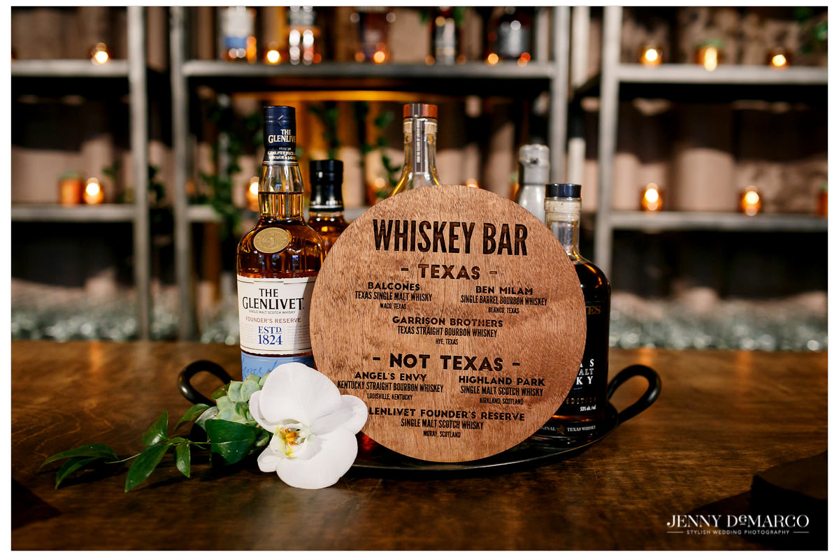 A whiskey bar welcomes guests to the reception.