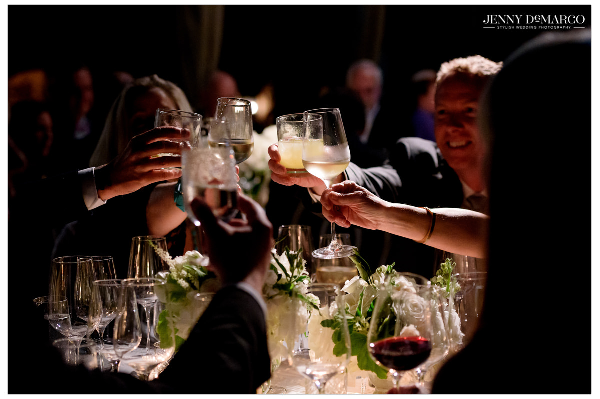 Guests cheers their glasses as toasts are given.