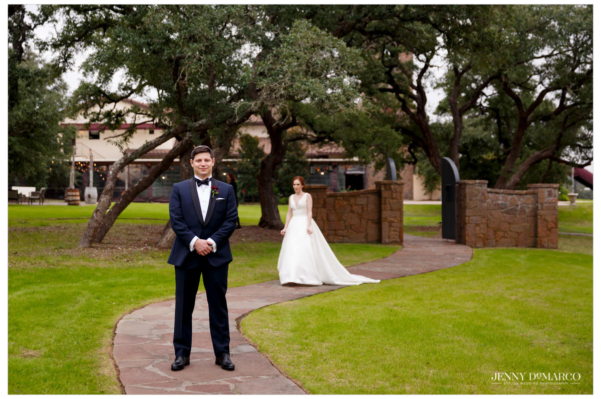 Bride sneaks up on her husband for the first look.