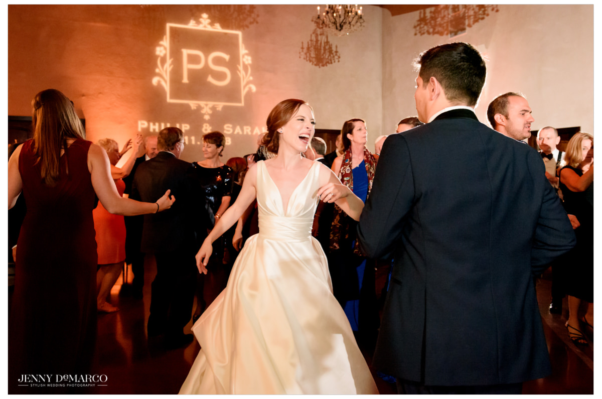 Guests join the bride and groom on the dance floor.