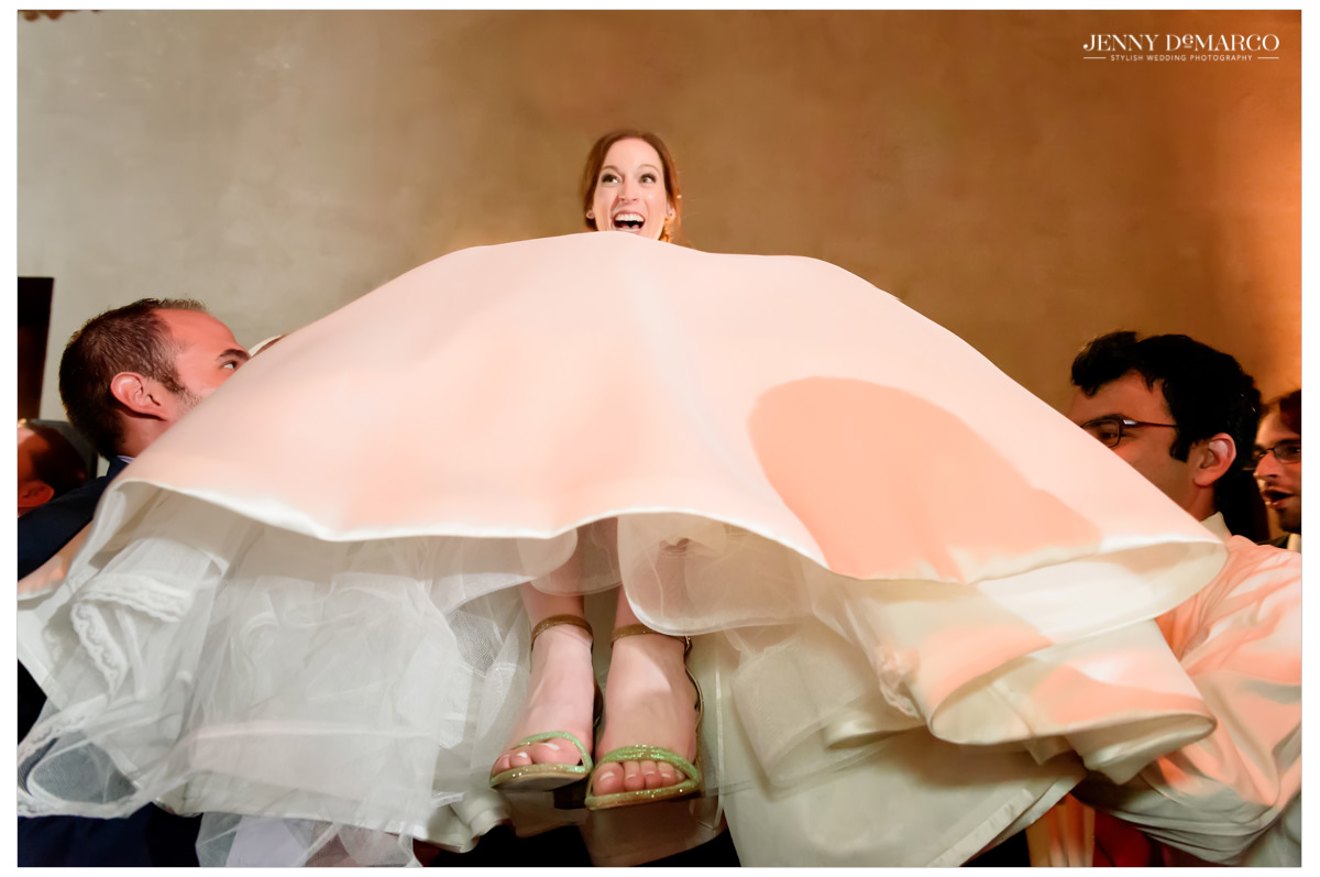 The bride is life high on a chair.