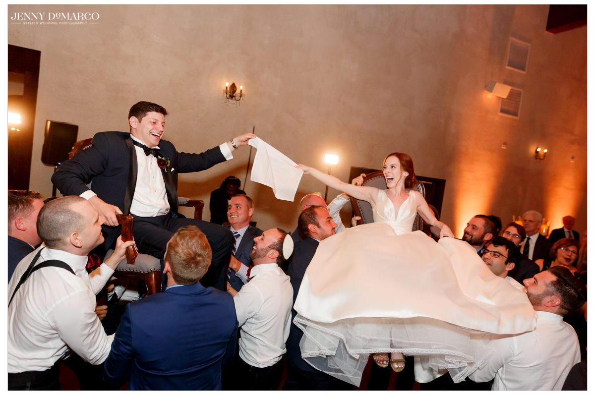 The new married couple celebrate with a Jewish tradition.