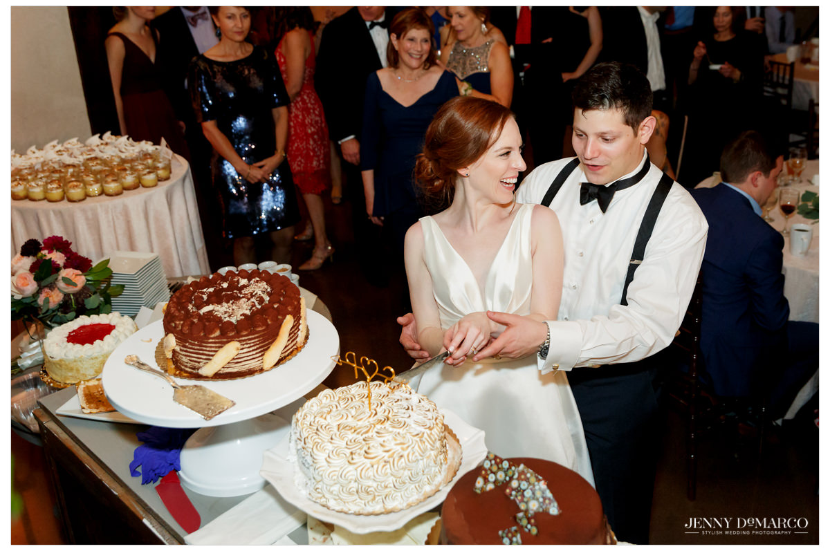 The couple cuts their wedding cake together.
