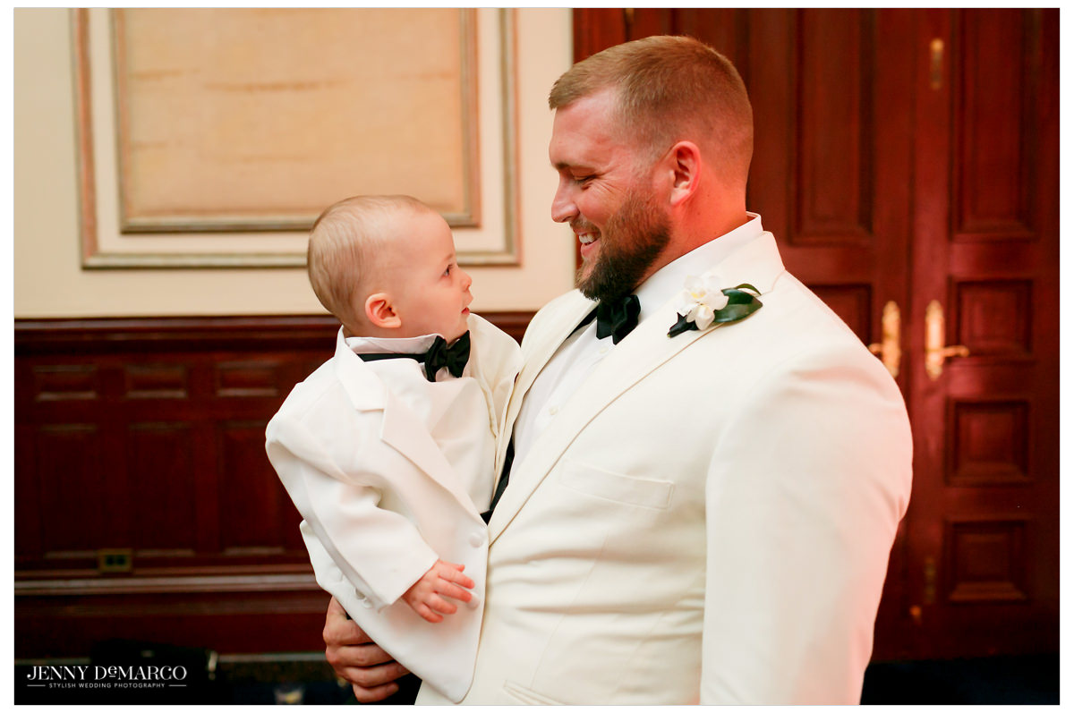 Groom poses with his ring bearer.