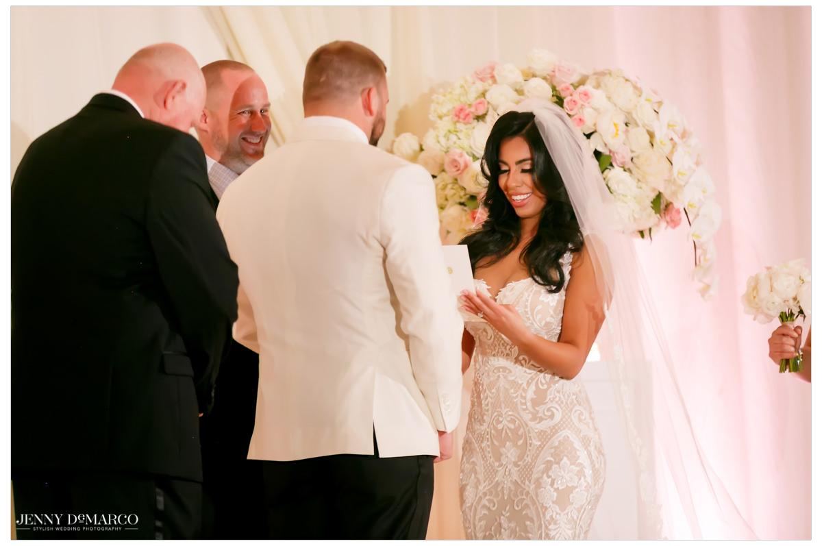 Bride reads her vows.