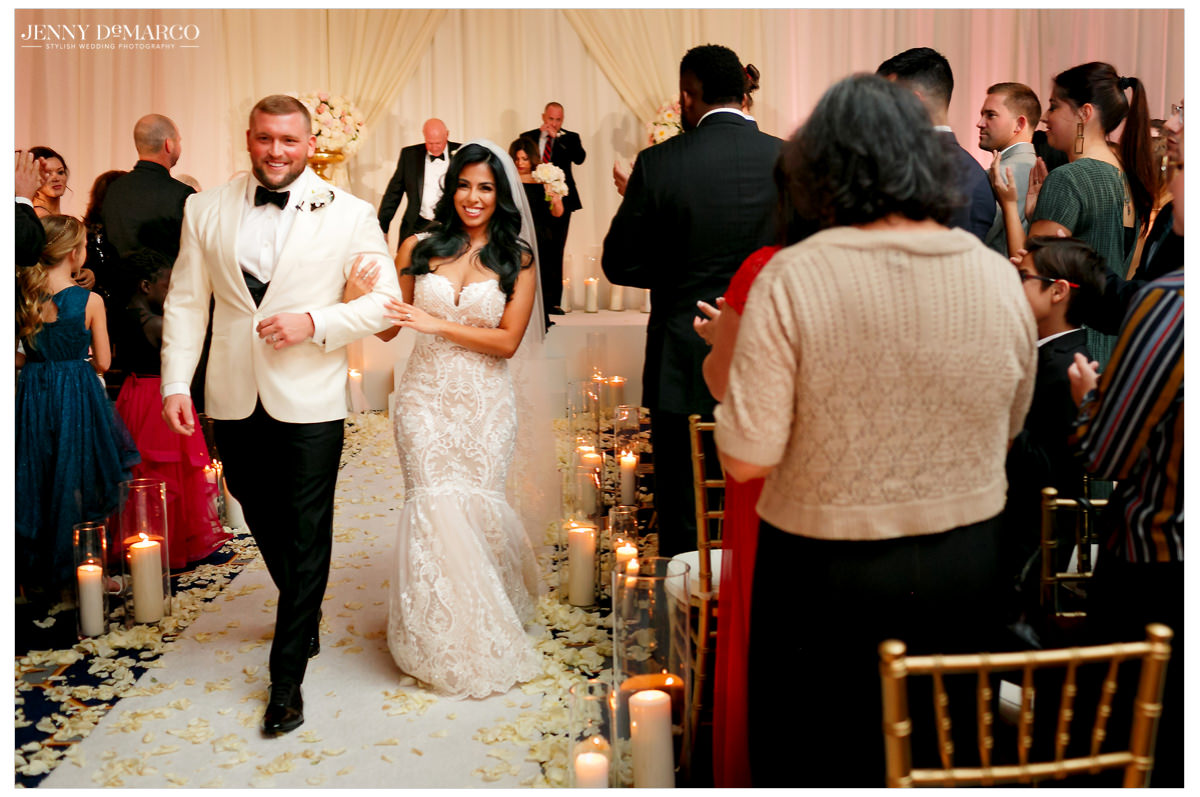 Bride and groom walk down the aisle.