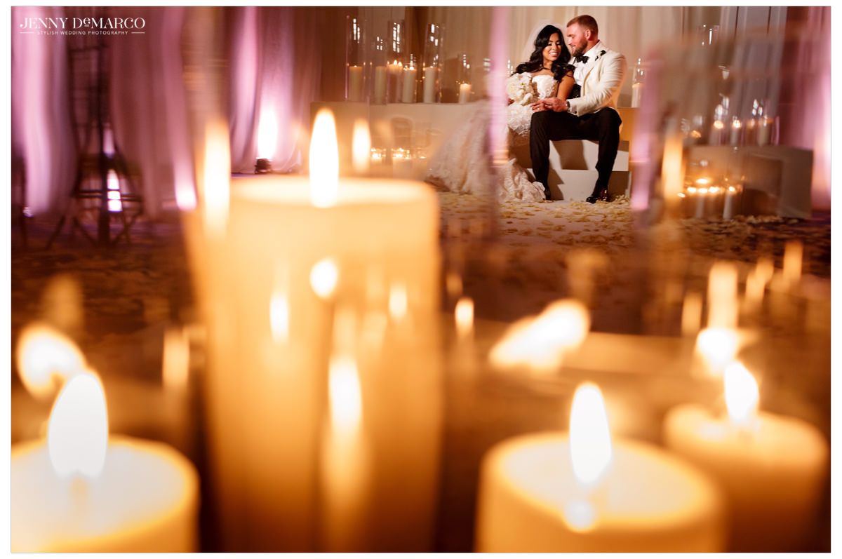 Intimate photos of bride and groom sitting amongst candles.