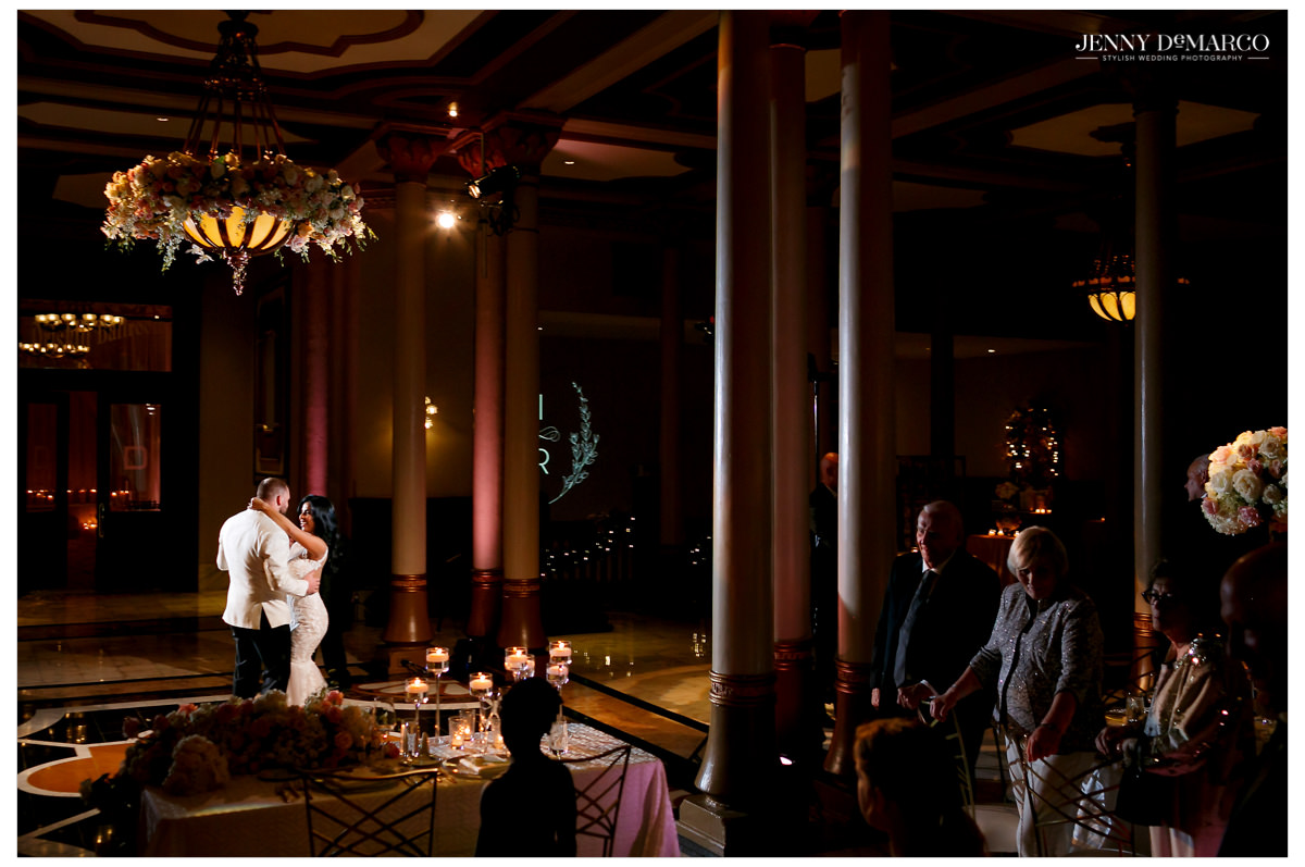 The couple dancing in front of their guests.