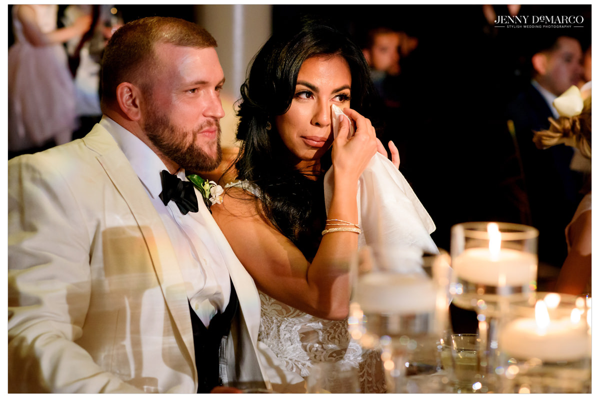 Bride sheds a tear during toasts.