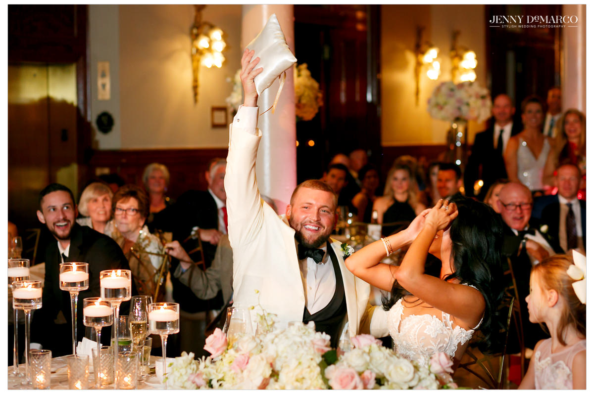 Groom reacts to toasts.