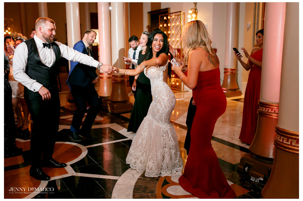 The couple dances with their guests.