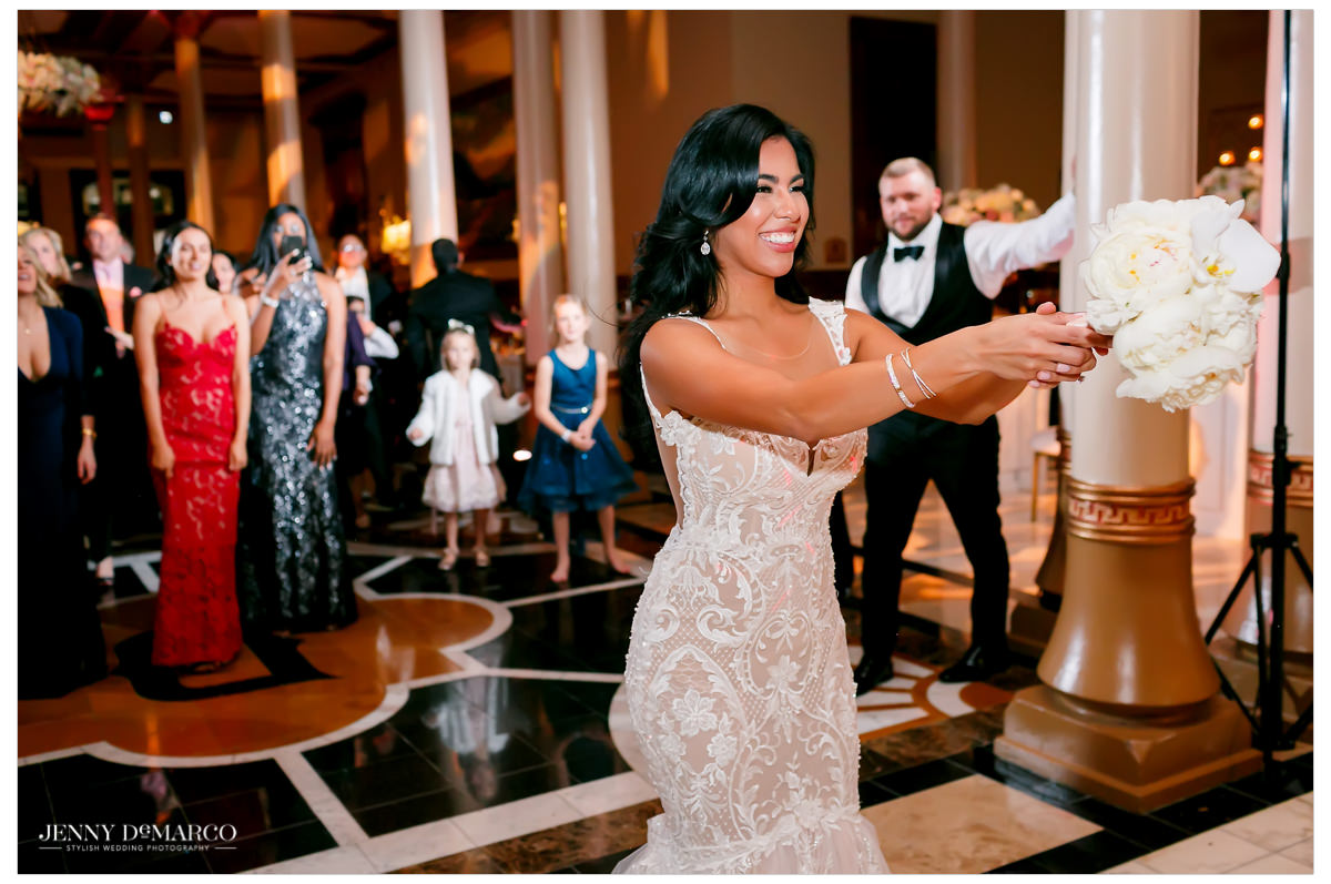 Bride throws her bouquet to all the women.