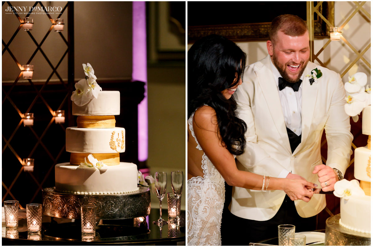 The couple cuts their white and gold wedding cake.