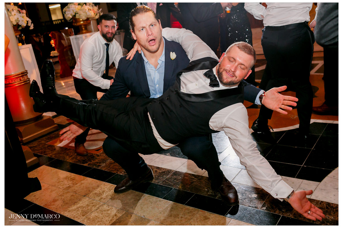 Groom is carried by his buddy.