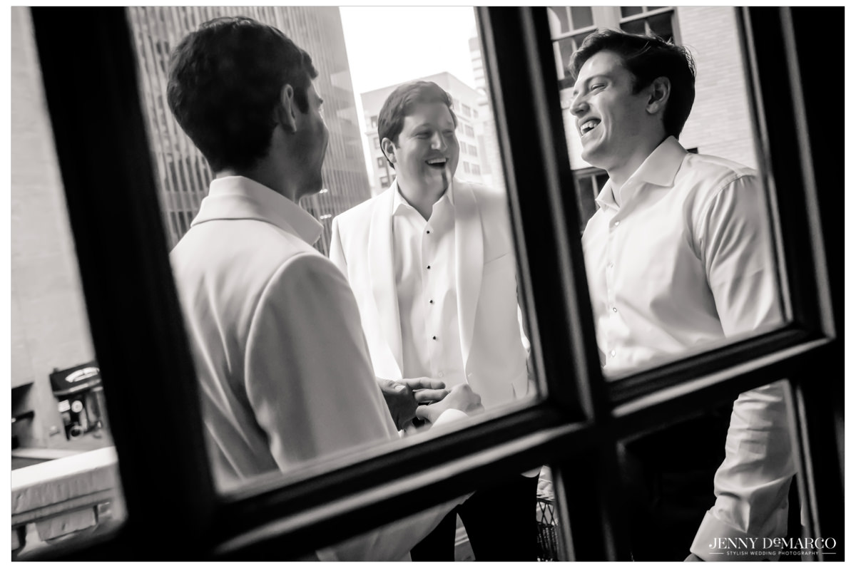 Groom shares a moment with his groomsmen.