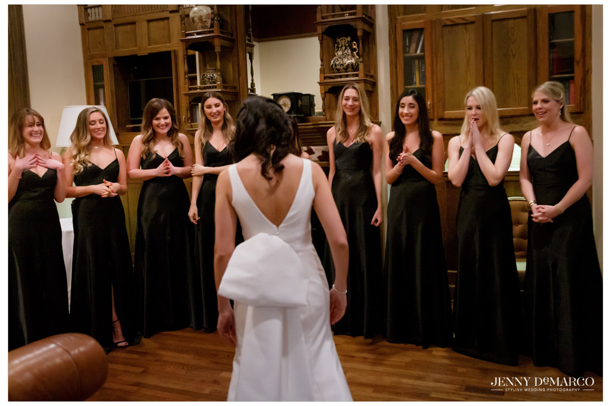 Bridesmaids are in awe at their first look with the bride.
